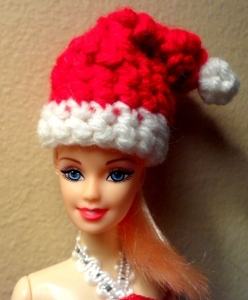 16a93dd9ca2 Make an adorable Fashion Doll Santa Hat for your child s Barbie dolls. Free  crochet Christmas patterns like this one are so fun when you can play with  them ...
