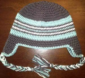 80a99aabaae The colors of this Adult Braided Ear Flap Hat are just gorgeous  they bring  a sense of relaxation and peace. Crocheted hats like this one are nice to  have ...