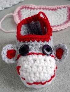 e6e3e17fb6a If you love the look of the traditional sock monkey then you ll love the  look and purpose of these Sock Monkey Booties. Free crochet slipper patterns  are ...