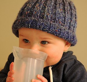 This adorable knit baby hat pattern is the quintessential fall hat for a  sweet little boy or girl. The Rolled Brim Speckled Beanie is a simple  ribbed beanie ... c46562f5409