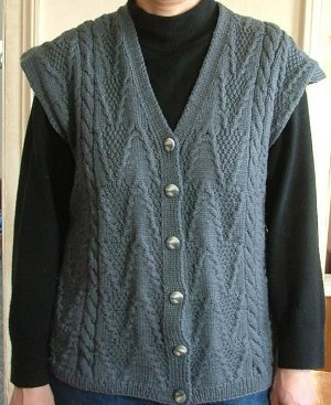 """This cable knit vest is inspired by this plump plied wool yarn that makes cables pop, Lisa created a cable knit vest that is the perfect """"weekend"""" design. It's knitting at its best, with fun stitch patterns in a big gauge that knits up quickly."""
