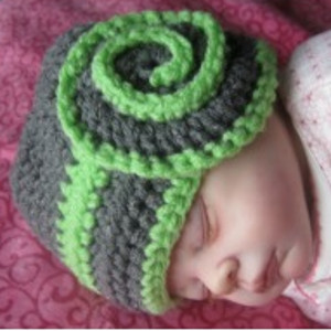 dc4ae877e15 Dress up your heavenly baby with a Celestial Swirl Baby Hat. As gorgeous as swirls  of stars in the sky
