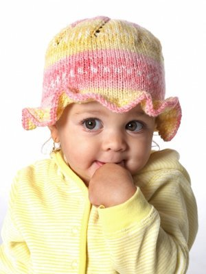 This darling baby hat knitting pattern features a sweet little ruffle  around the edge to guard baby s face from the sun. Baby s Ruffle Hat is a  great ... 1b05aa39f55