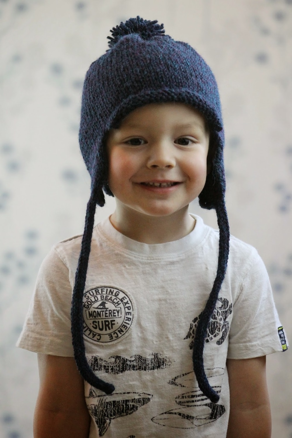 Knitting Pattern For Toddler Hat With Earflaps : All in the Family Earflap Hat AllFreeKnitting.com