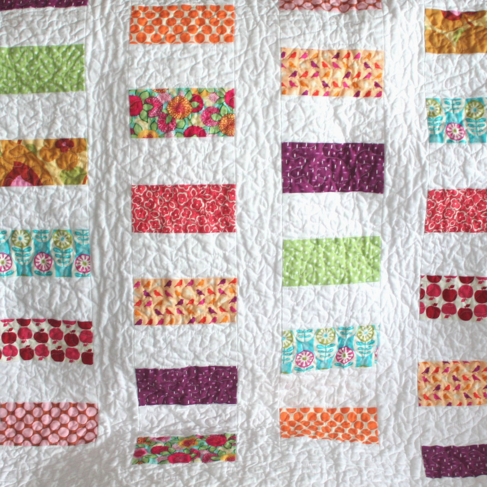 Free Pieced Baby Quilt Patterns : Colorful Coins Baby Quilt Pattern FaveQuilts.com