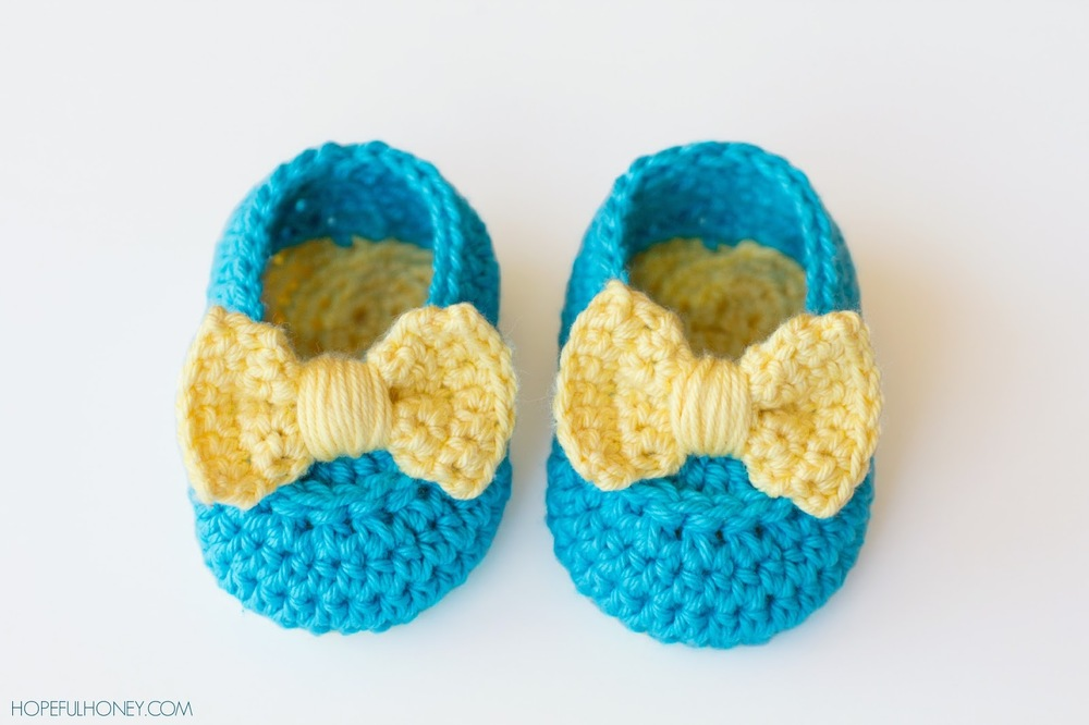 What Is Crochet : Yellow Bow Easy Crochet Baby Booties FaveCrafts.com