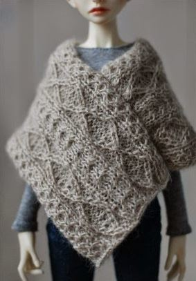 Knitting Pattern Doll Poncho : Aran Doll Poncho AllFreeKnitting.com