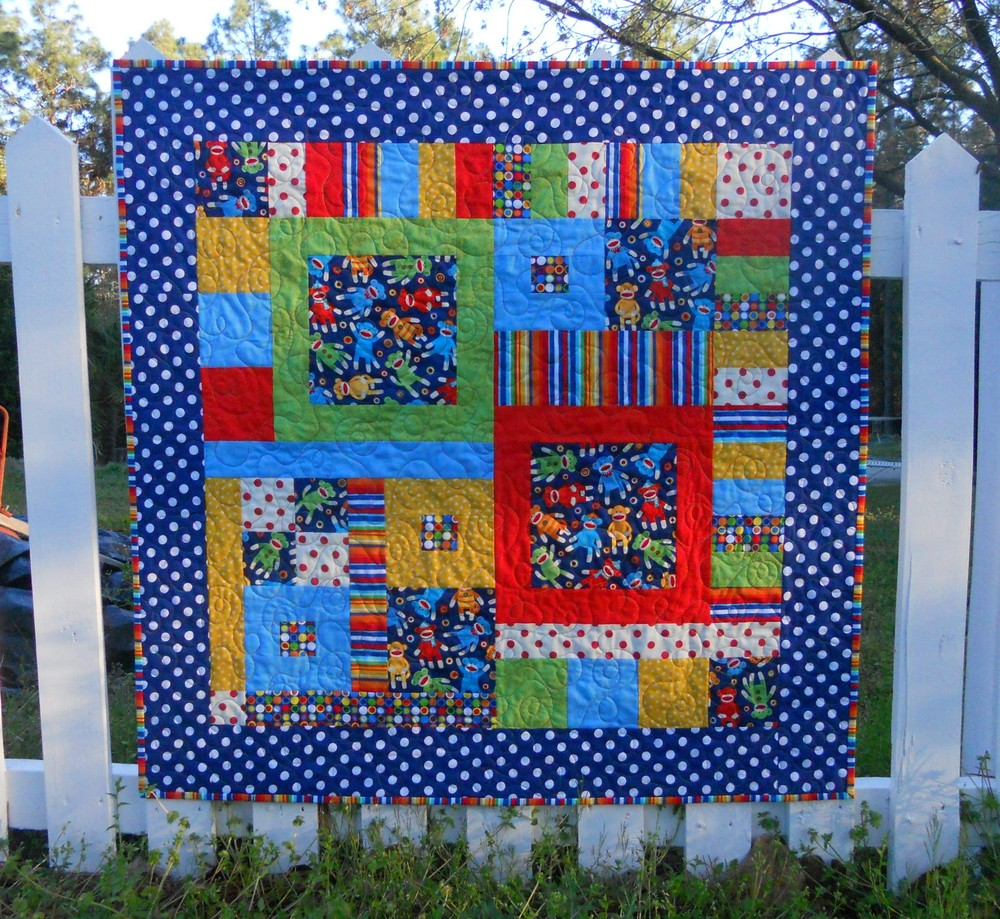 Free Quilt Patterns For Large Prints : Sock Monkey Circus Baby Quilt FaveQuilts.com