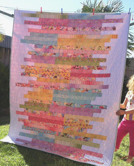 Free Quilt Patterns Using Jelly Roll Strips : Sugar Almonds Jelly Roll Quilt Pattern FaveQuilts.com