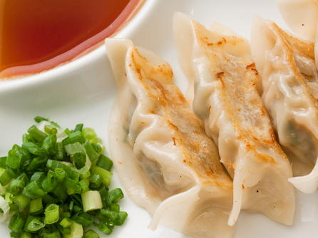 Pot sticker dumplings with ginger soy dipping sauce for Appetizer chinese cuisine