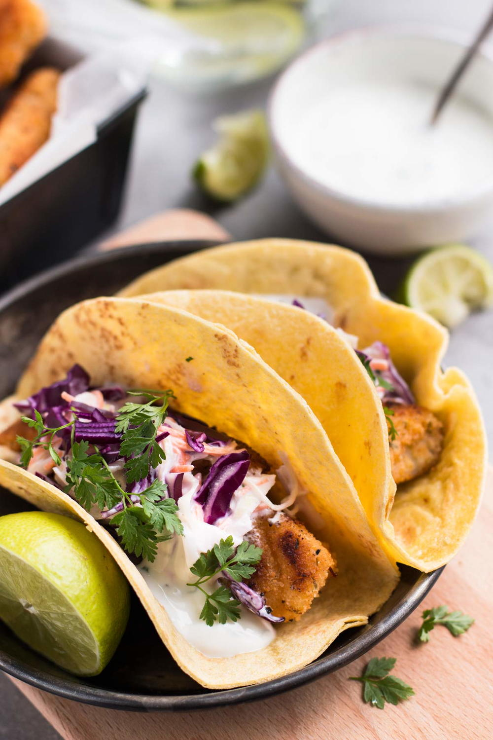 Baja fish tacos with creamy cilantro lime slaw recipe for Slaw recipe for fish tacos