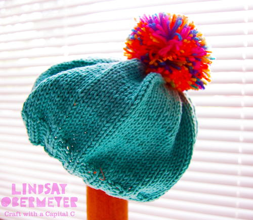 Pom Pom Beanie Knitting Pattern : Slouchy Pom Beanie AllFreeKnitting.com
