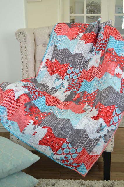 Fly Away Hexie Baby Quilt Favequilts Com