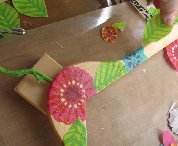 Repeat steps 4 through 6 with additional flower and leaf images, overlapping as desired wrapping carefully around hanger edges and around the metal hanger area. Dry completely.