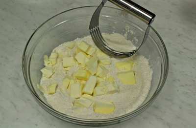 Sprinkle the butter on the flour