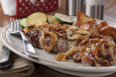 Onion Smothered Strip Steak