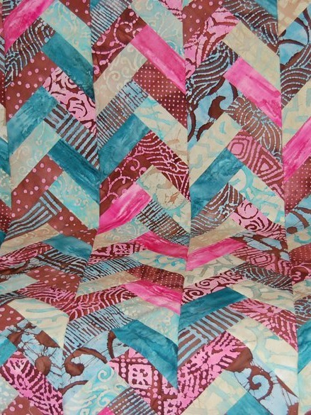 Quilt Patterns Made With Jelly Rolls : Jelly Roll Braid Quilt FaveQuilts.com