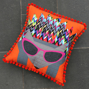 Add Pompoms to a Cushion or Pillow