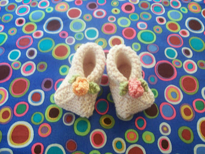 Flower On Top Baby Booties Knitting Pattern