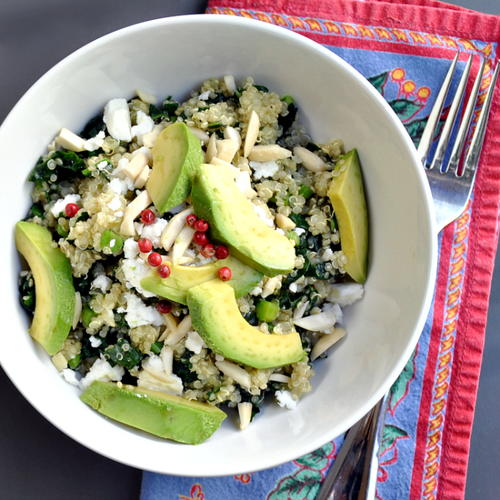 Warm Kale and Quinoa Salad with Avocado Almonds and Feta