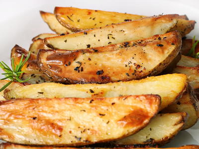 Oven-Roasted Potatoes with Rosemary & Whole Garlic Cloves