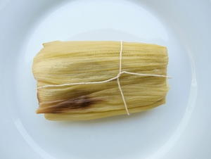 Tamales Stuffed with Chicken and Tomatillo Sauce
