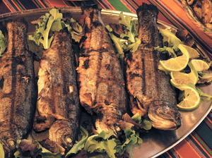 Grilled Las Cruces-Style Trout with Green Chile & Pecan Stuffing
