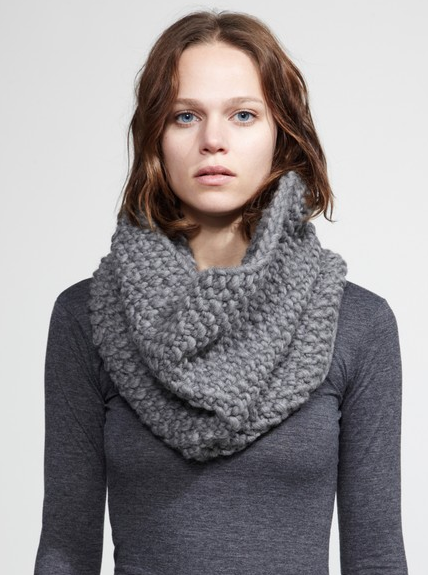 The snood is similar to an infinity scarf, which is a looped scarf that sits around the neck. They differ in that the snood sits higher on the neck and can often act like a hood. So while an infinity scarf could technically act like a snood, and a snood like an infinity scarf, there are some subtle differences.