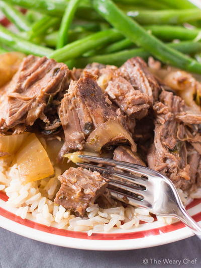 Slow Cooker Pot Roast Loaded With Garlic and Onions