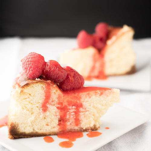 Lemon Cheesecake with Berry Drizzle