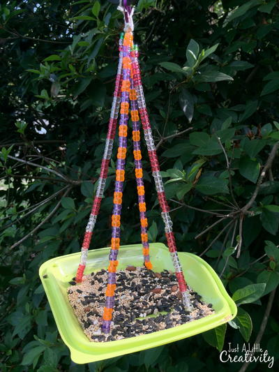 Beaded Bird Feeder from a Fast Food Salad Container