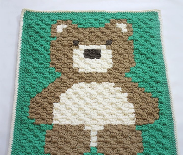 Image shows the Cuddly Teddy Bear Crochet Baby Blanket.