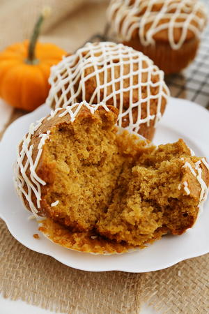 Vanilla-Glazed Pumpkin Gingerbread Muffins