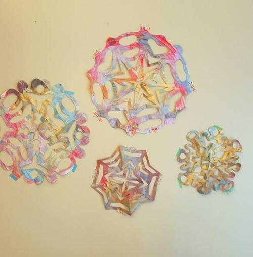 Giant Painted Newspaper Snowflakes