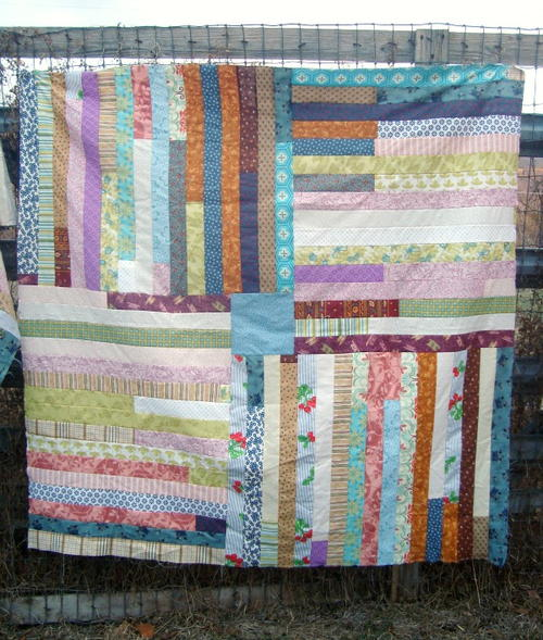 Simple Jelly Roll Quilt Tutorial FaveQuilts.com