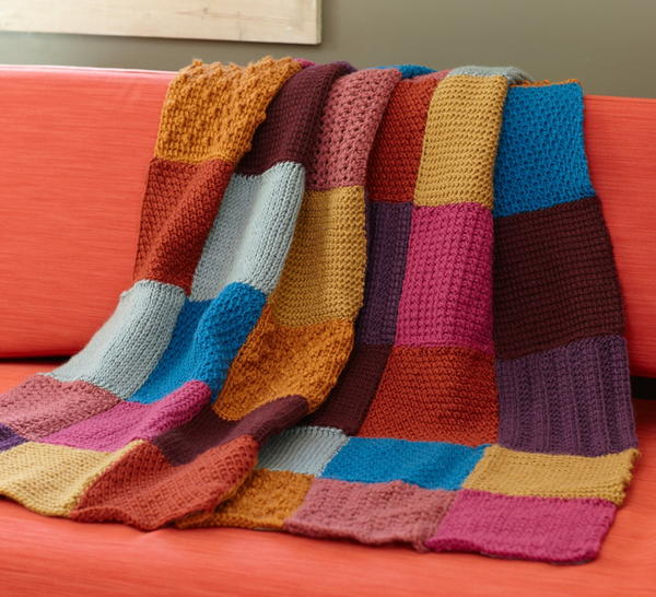 Image show the Granny Square Tunisian Throw.