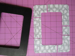 stack both frame shapes with edges lined up along grid on cutting mat using the ruler and knife cut sections as shown cutting through both layers at the