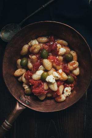 Gnocchi with Fresh Tomatoes, Green Olives, and Smoked Mozzarella
