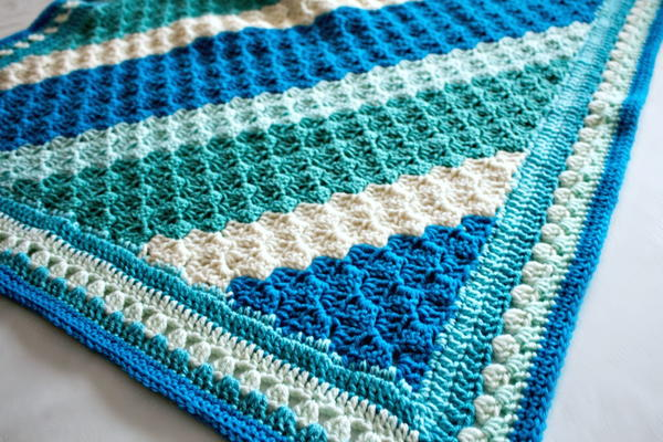 Image shows a close-up of the Crochet Casserole Blanket.