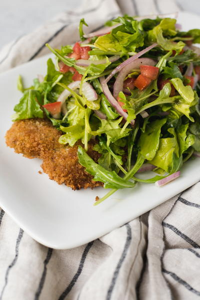 Veal Milanese with Arugula Tomato and Red Onion Salad
