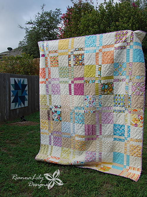 Disappearing 4-Patch Quilt with Layer Cakes