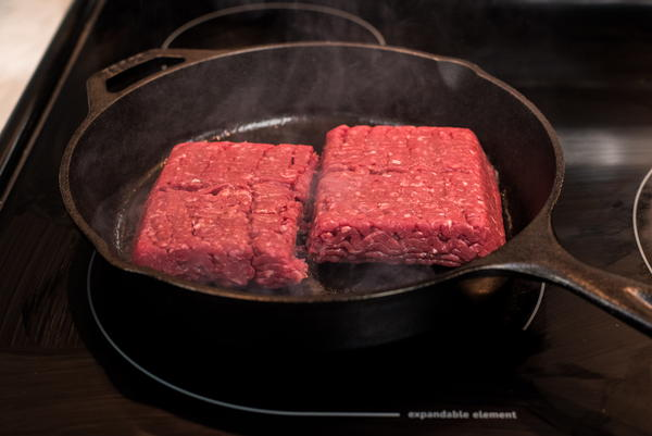 Add your ground beef to the center of the skillet.