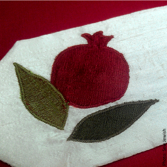 Image shows the Pomegranate Silk Applique made with straight point needles.