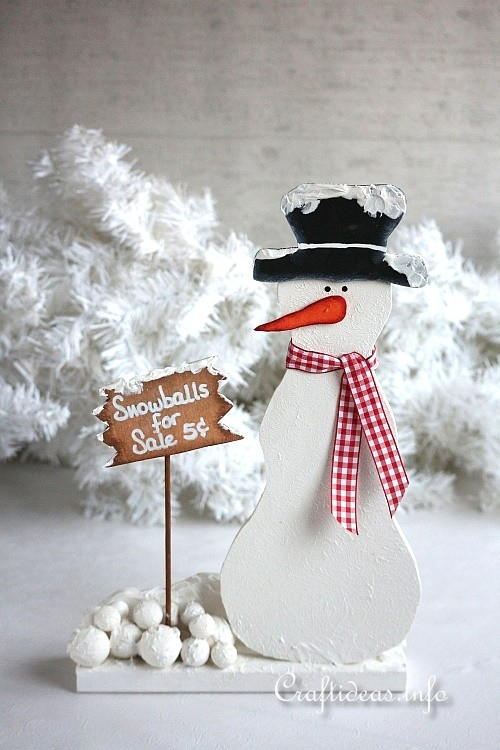 Wooden Snowman Selling Snowballs