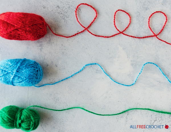 Image shows three skeins of yarn being unraveled.