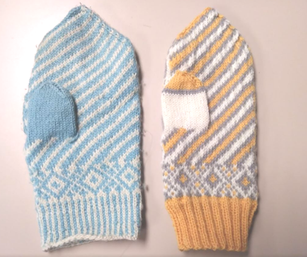 Two differently sized mittens