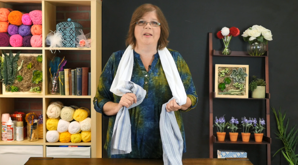 Image shows Mary Beth wearing the DIY Kitchen Towel Boa in the craft studio.