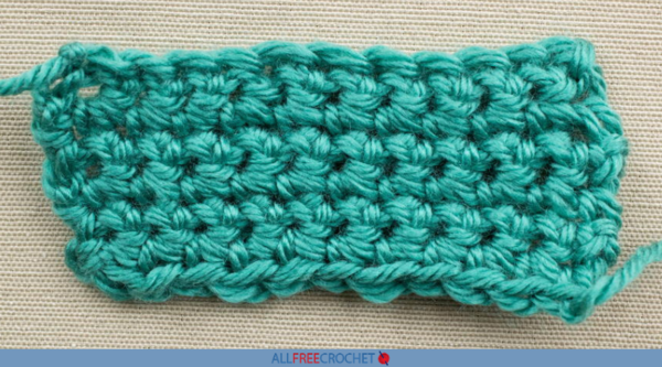 Image shows a single crocheted swatch of green yarn.