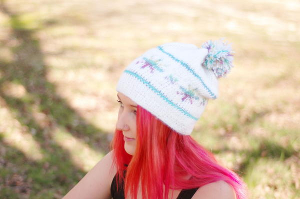 image shows the Stunning Snowflake Tunisian Crochet Hat.