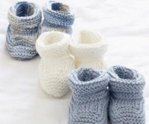 Babies white set new born 2 cardigan hat mittens and booties .